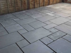 Grey paving slabs in garden
